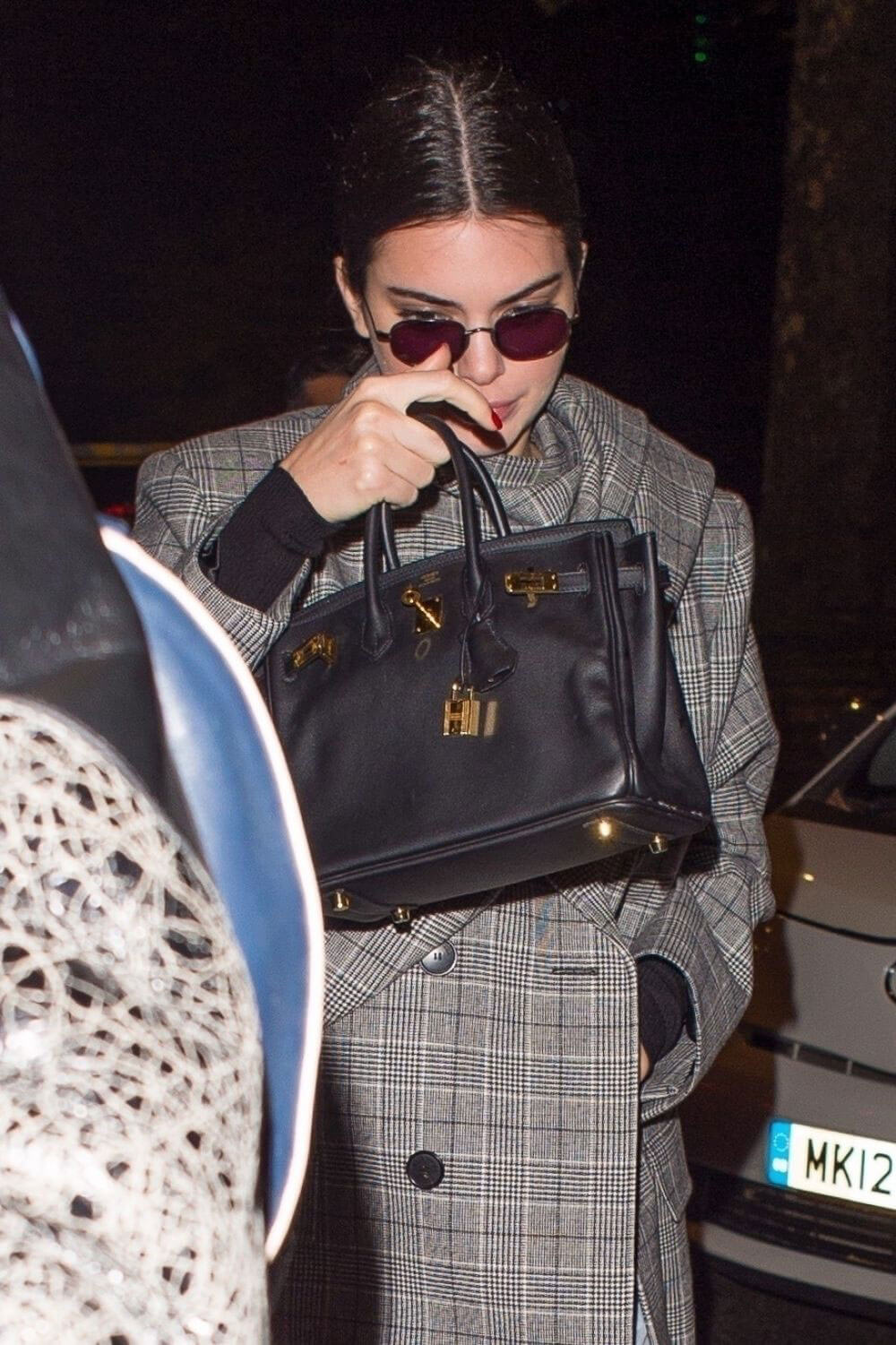 Kendall Jenner wears Long Coat with Ripped Jeans Arrives at China Tang in London