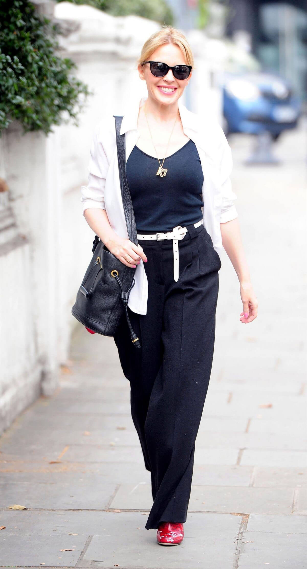 Kylie Minogue wears Black Tank Top & Black Pants Leaves Her Home in London