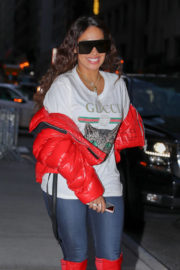 La La Anthony wears Red Jackets & Red Boots Night Out in New York