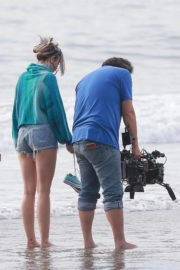 Miley Cyrus wears Blue Top & Denim Shorts on the Set of Her New Music Video in Venice
