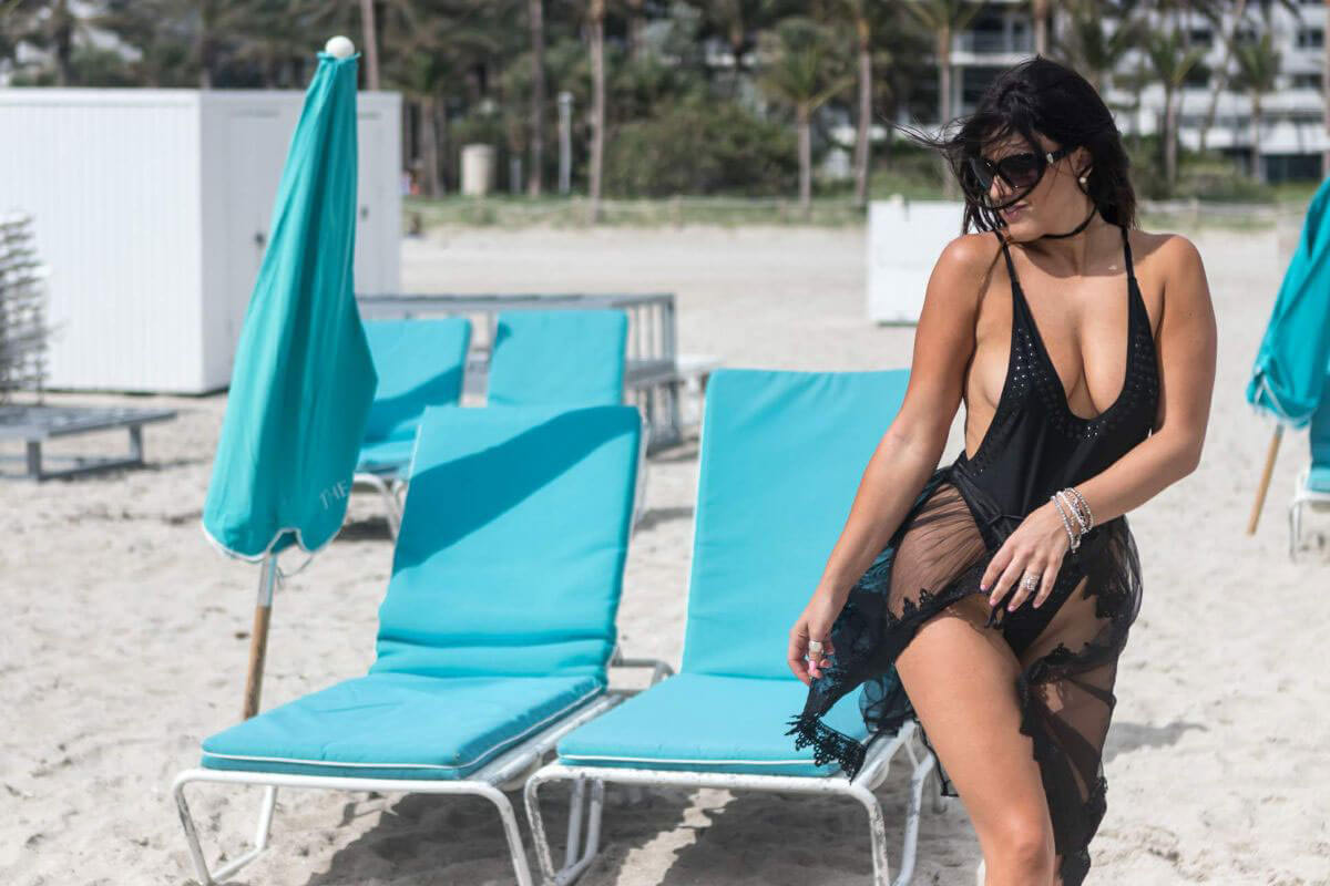 Model Claudia Romani wears Black Swimsuit at South Beach in Miami