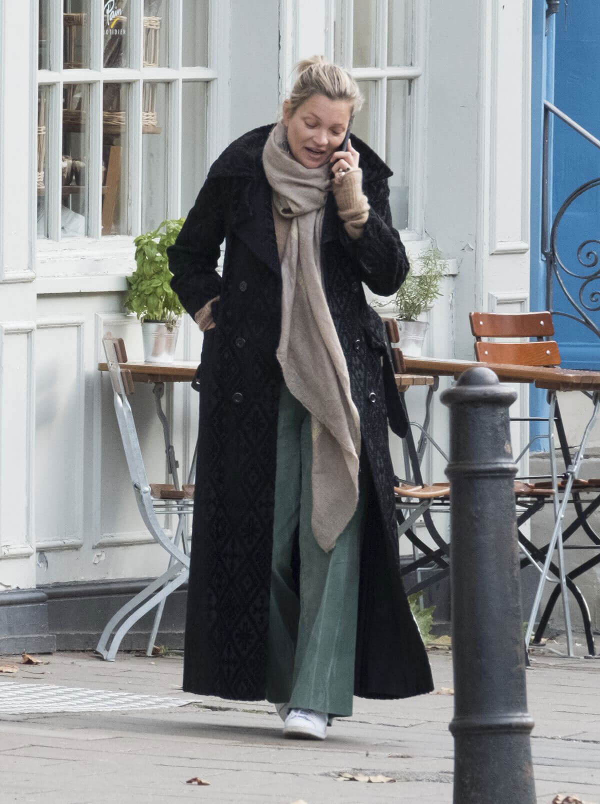 Model Kate Moss wears Winter Coat & Light Green Pants Out in London