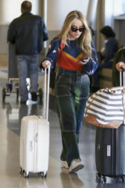 Sabrina Carpenter wears Different Outfits at LAX Airport in Los Angeles