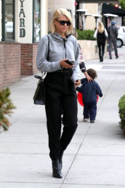 Sofia Richie wears Short Grey Top & Black Trousers Out Shopping in Beverly Hills