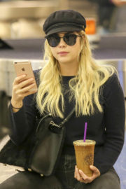 Ashley Benson wears Black Top & Jeans at LAX Airport in Los Angeles