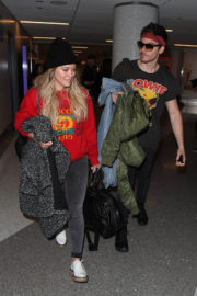 Hilary Duff and Matthew Coma Stills at LAX Airport in Los Angeles 2017/12/21