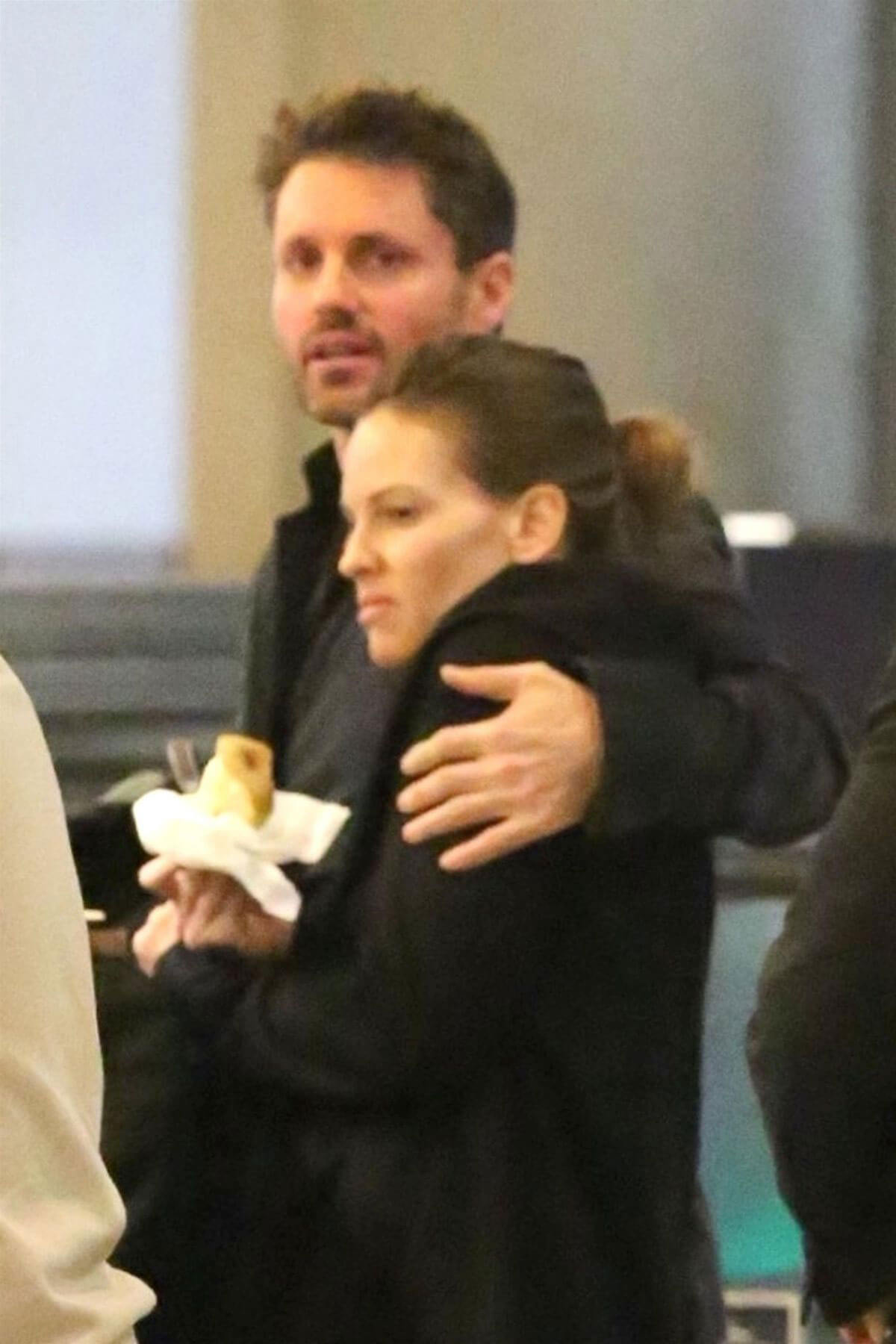 Hilary Swank and Philip Schneider Stills at LAX Airport in Los Angeles 2017/12/17