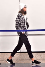 Kaia Gerber wears Checked Short & Jeans at Los Angeles International Airport