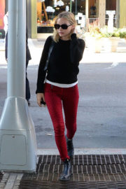 Margot Robbie in Black Sweater & Red Check Trousers Out and About in New York