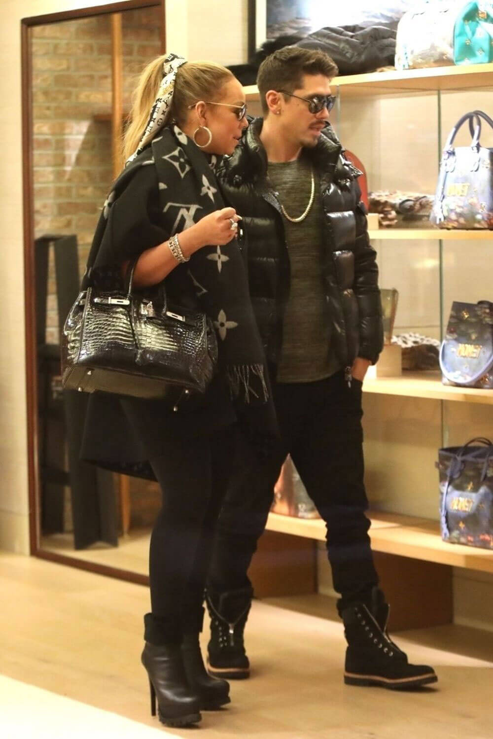 Mariah Carey and Bryan Tanaka Shopping Stills at Louis Vuitton Store in Aspen 2017/12/23