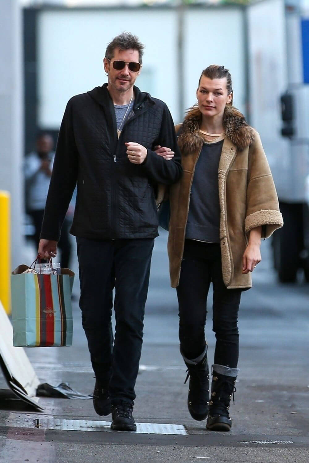 Milla Jovovich and Paul W. S. Anderson Shopping Stills at Prada in Beverly Hills 2017/12/21
