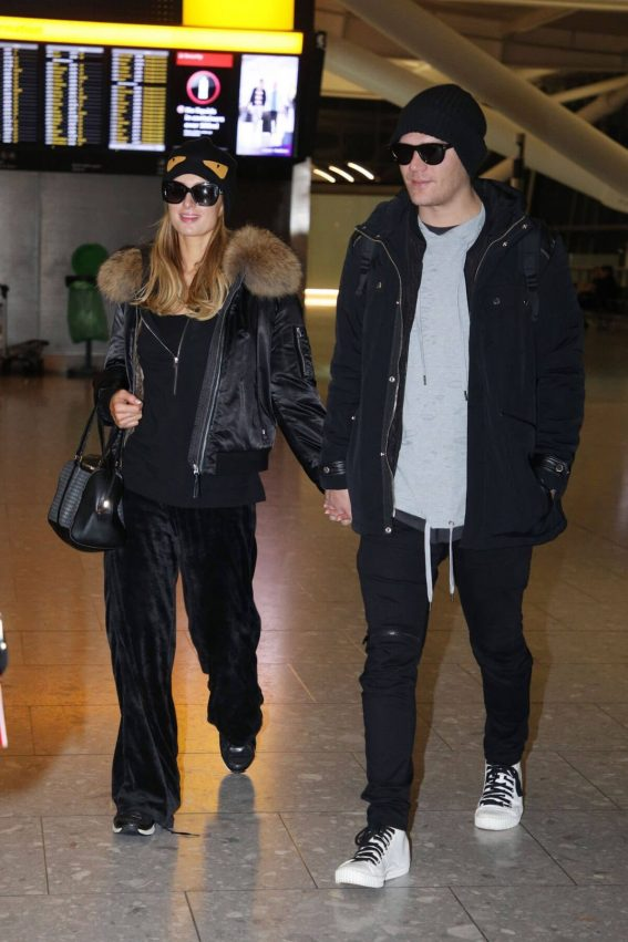 Paris Hilton and Chris Zylka Stills at Heathrow Airport in London 2017/12/20