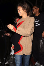 Zendaya wears Loose Sweater & Blue Jeans Out for Dinner in Beverly Hills