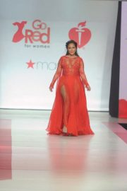 Adrienne Bailon Stills in Gown by Galia Lahav at Red Dress 2018 Collection Fashion Show in New York 2018/02/08