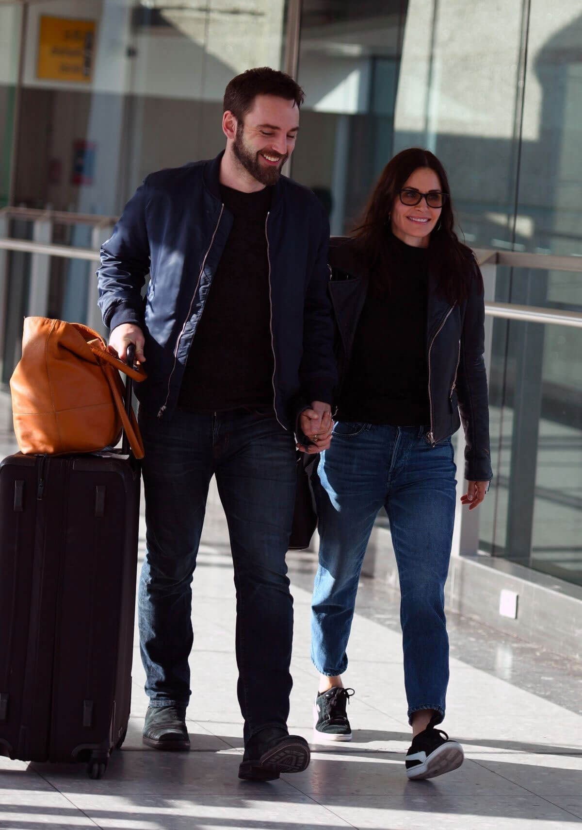 Courteney Cox and Johnny McDaid Stills at Heathrow Airport in London 2018/02/17