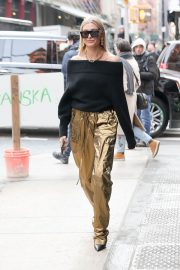 Hailey Baldwin Stills in a Gold Pants Out in New York 2018/02/09