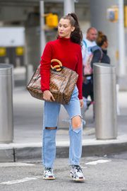 Bella Hadid in Ripped Jeans at JFK Airport in New York 2018/06/02 3