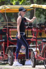 Kaley Cuoco Riding a Trike Bike at a Park in Los Angeles 2018/07/16 10