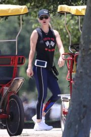 Kaley Cuoco Riding a Trike Bike at a Park in Los Angeles 2018/07/16 11