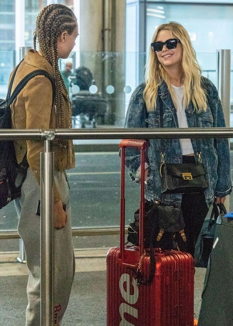 Cara Delevingne And Ashley Benson At Heathrow Airport In