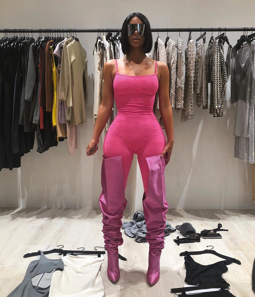 Kim Kardashian displays her figure in pink bodysuit and matching thigh-high boots 1