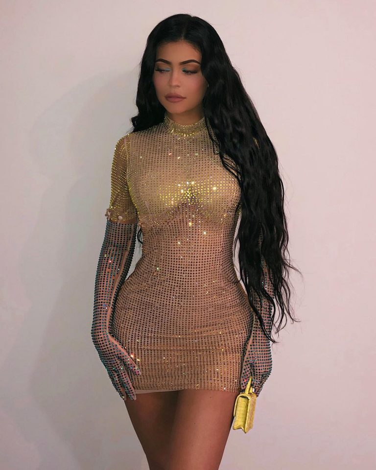 Kylie Jenner Sizzles in Shimmery Gold Bodycon Dress 1