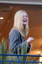 Elle Fanning at balcony of the Martinez Hotel in the evening of the Cannes Film Festival in France 2019/05/13 10