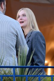 Elle Fanning at balcony of the Martinez Hotel in the evening of the Cannes Film Festival in France 2019/05/13 11