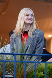 Elle Fanning at balcony of the Martinez Hotel in the evening of the Cannes Film Festival in France 2019/05/13 12
