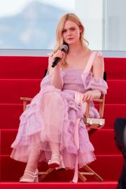 Elle Fanning Giving an Interview on the Croisette in Cannes 2019/05/14 2