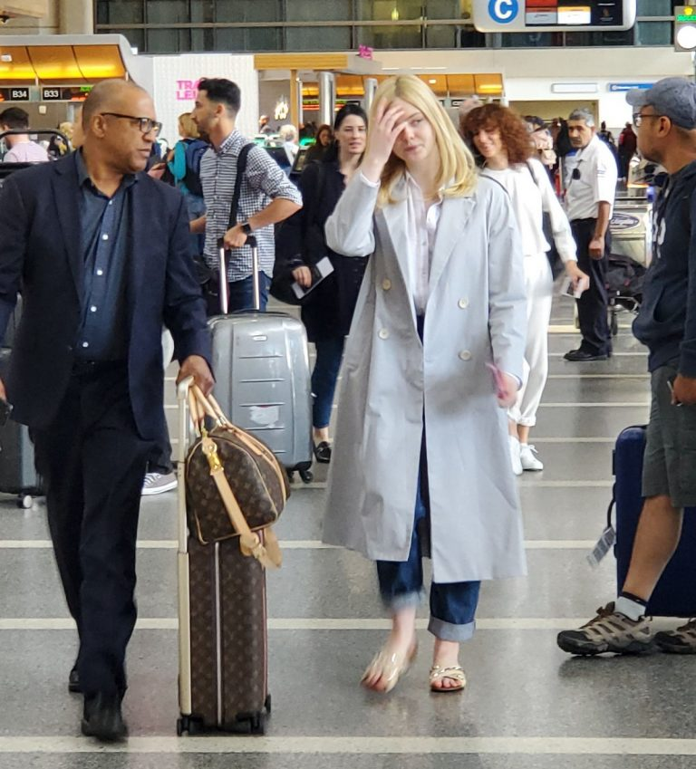 Elle Fanning Visits Boards A Flight at LAX Airport in Los Angeles 2019/05/11 1