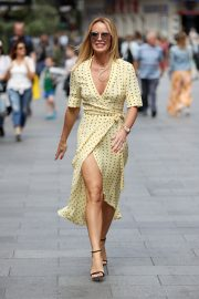 Amanda Holden flashes her legs in high split yellow polka dot dress Out in London 2019/07/08 2