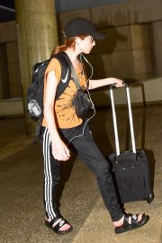 Anna Kendrick in Light Orange Top and Adidas Originals 3-Stripe Track Pants Out at LAX Airport in Los Angeles 2019/07/23 7