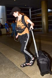 Anna Kendrick in Light Orange Top and Adidas Originals 3-Stripe Track Pants Out at LAX Airport in Los Angeles 2019/07/23 8