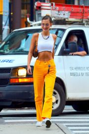 Bella Hadid flashes toned abs in short top and yellow pants out in New York 2019/07/22 8