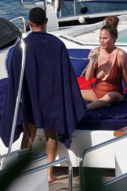 Chrissy Teigen flashes her Bust in Swimsuit on a Yacht in Portofino, Italy 2019/07/03 3