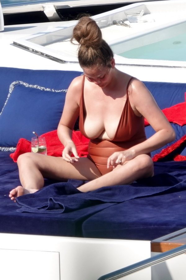 Chrissy Teigen flashes her Bust in Swimsuit on a Yacht in Portofino, Italy 2019/07/03 6