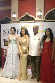 Sridevi's first wax statue in Singapore Madame Tussauds, unveiled by Boney Kapoor with daughters Janhvi and Khushi. 2