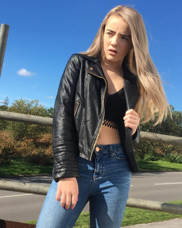 Alice Mary Jones seen in black leather jacket and blue jeans during photoshoot 2