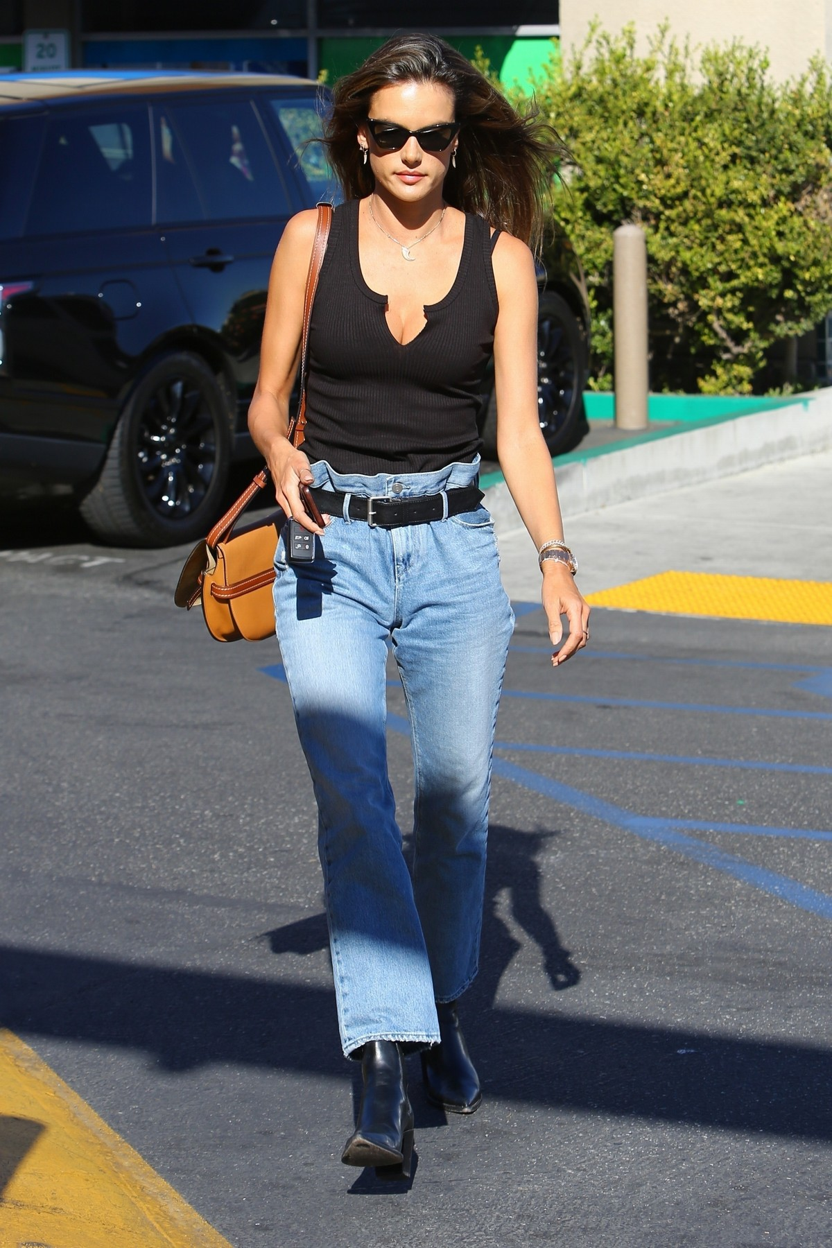 Alessandra Ambrosio in Black Top and Blue Jeans out in Los Angeles 2019/11/18 3