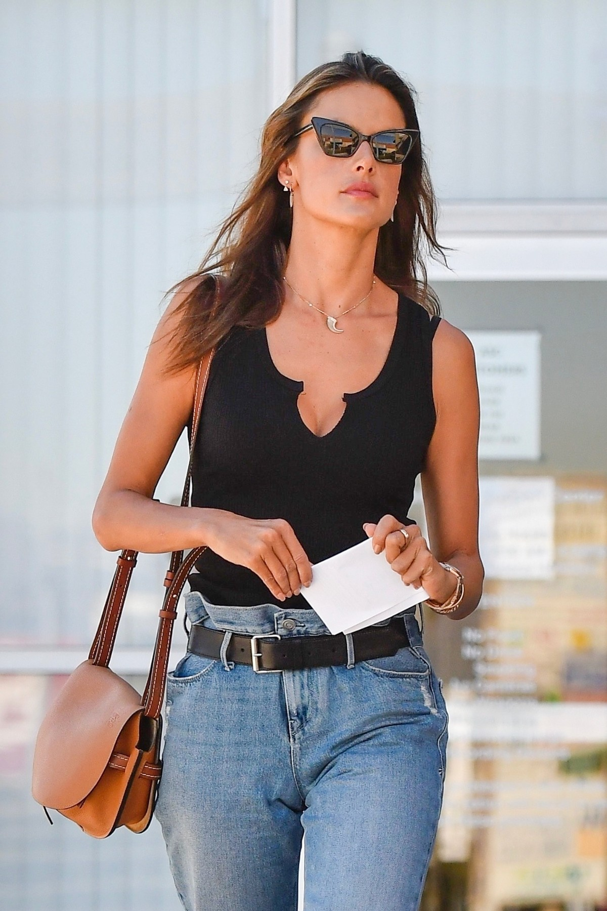 Alessandra Ambrosio in Black Top and Blue Jeans out in Los Angeles 2019/11/18 13