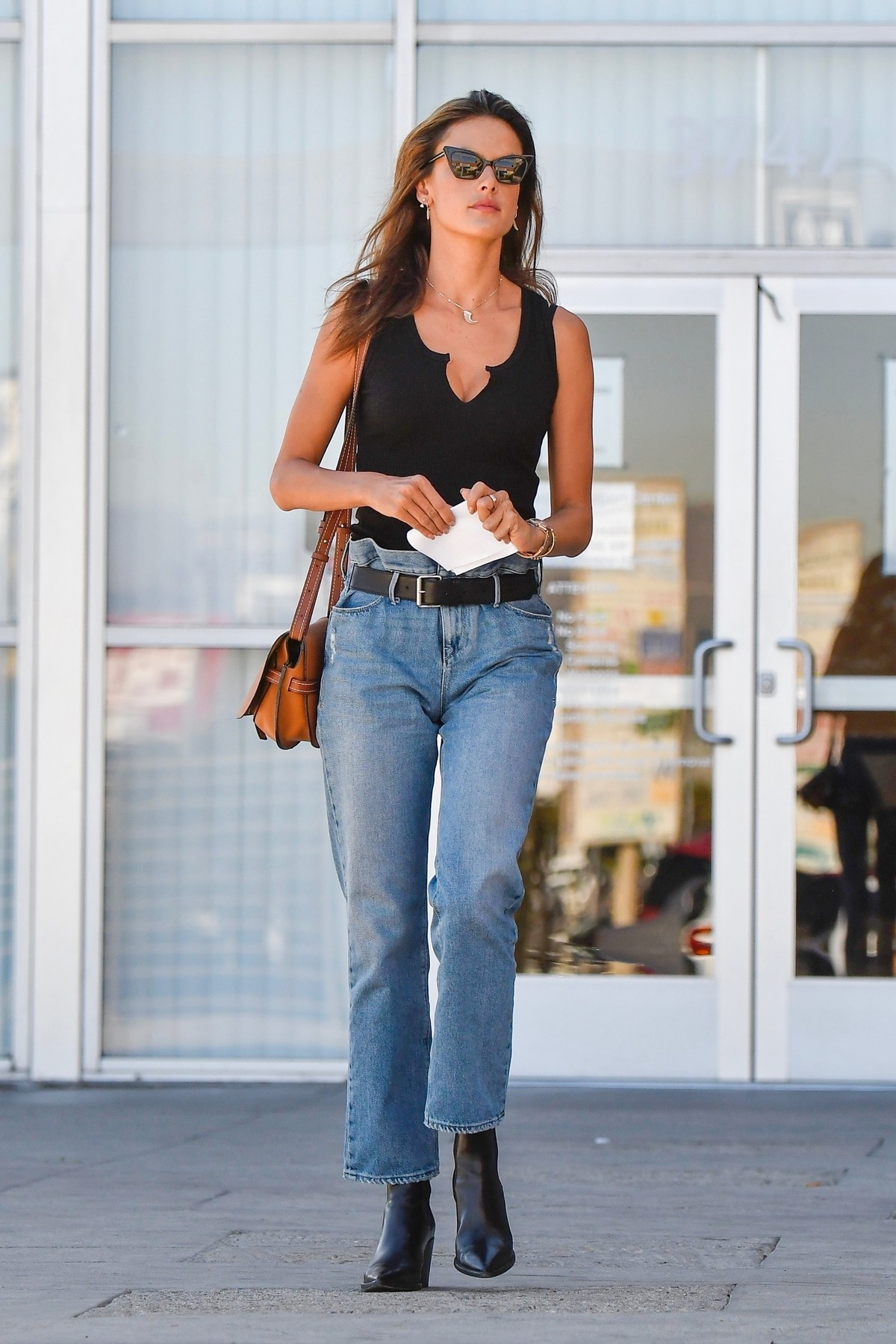Alessandra Ambrosio in Black Top and Blue Jeans out in Los Angeles 2019/11/18 14