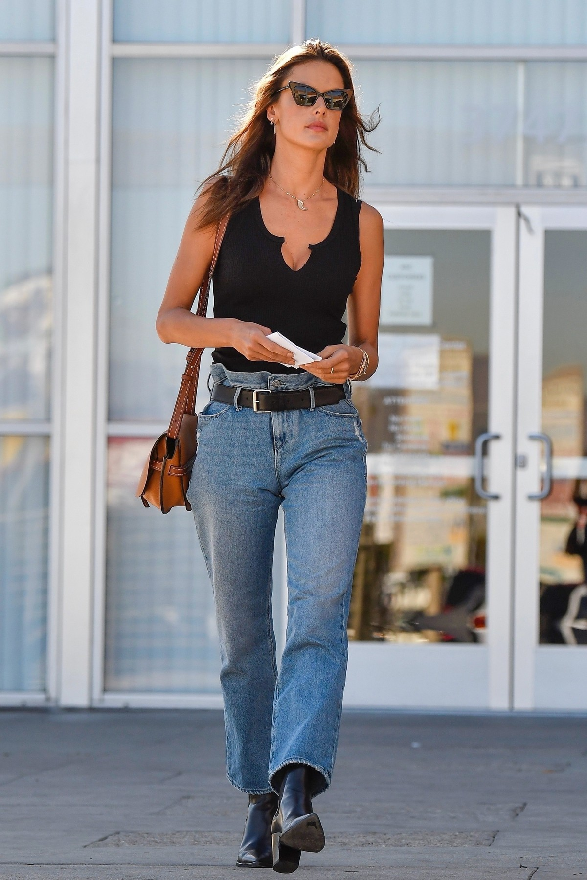 Alessandra Ambrosio in Black Top and Blue Jeans out in Los Angeles 2019/11/18 16