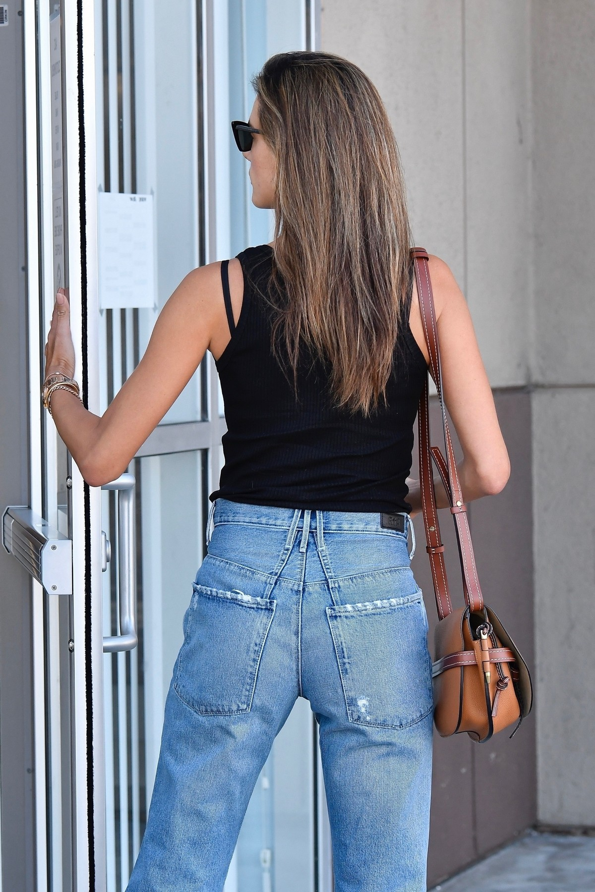 Alessandra Ambrosio in Black Top and Blue Jeans out in Los Angeles 2019/11/18 17