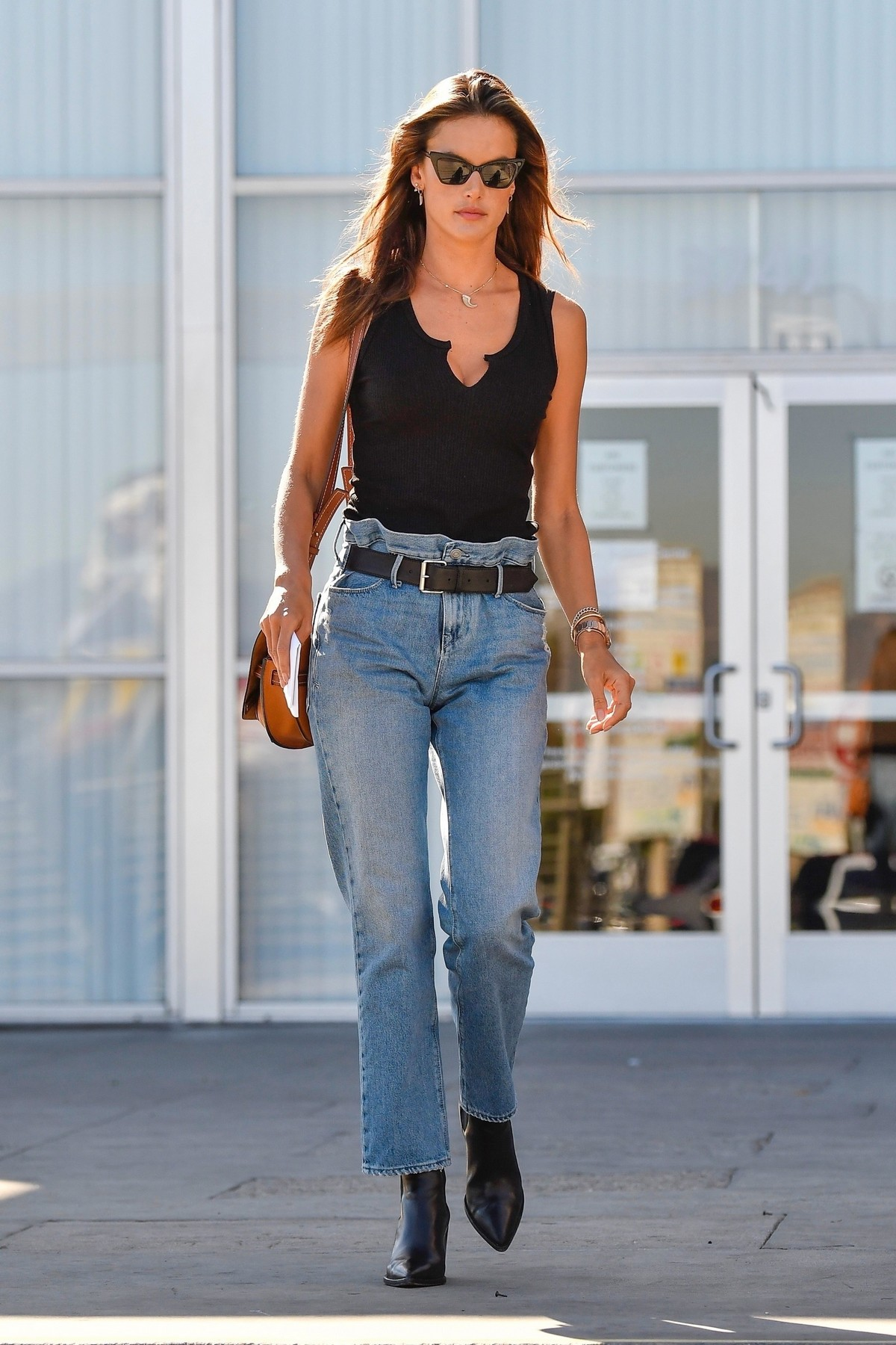 Alessandra Ambrosio in Black Top and Blue Jeans out in Los Angeles 2019/11/18 18