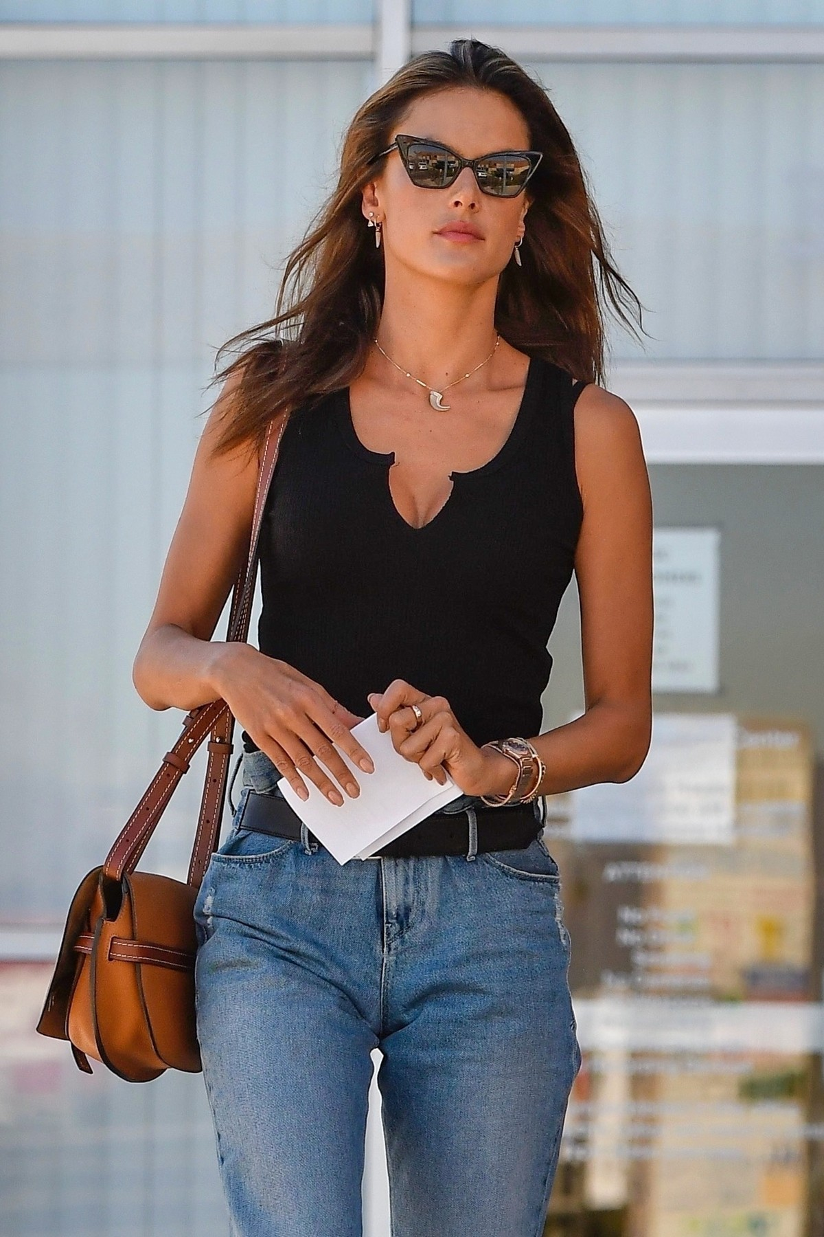Alessandra Ambrosio in Black Top and Blue Jeans out in Los Angeles 2019/11/18 19