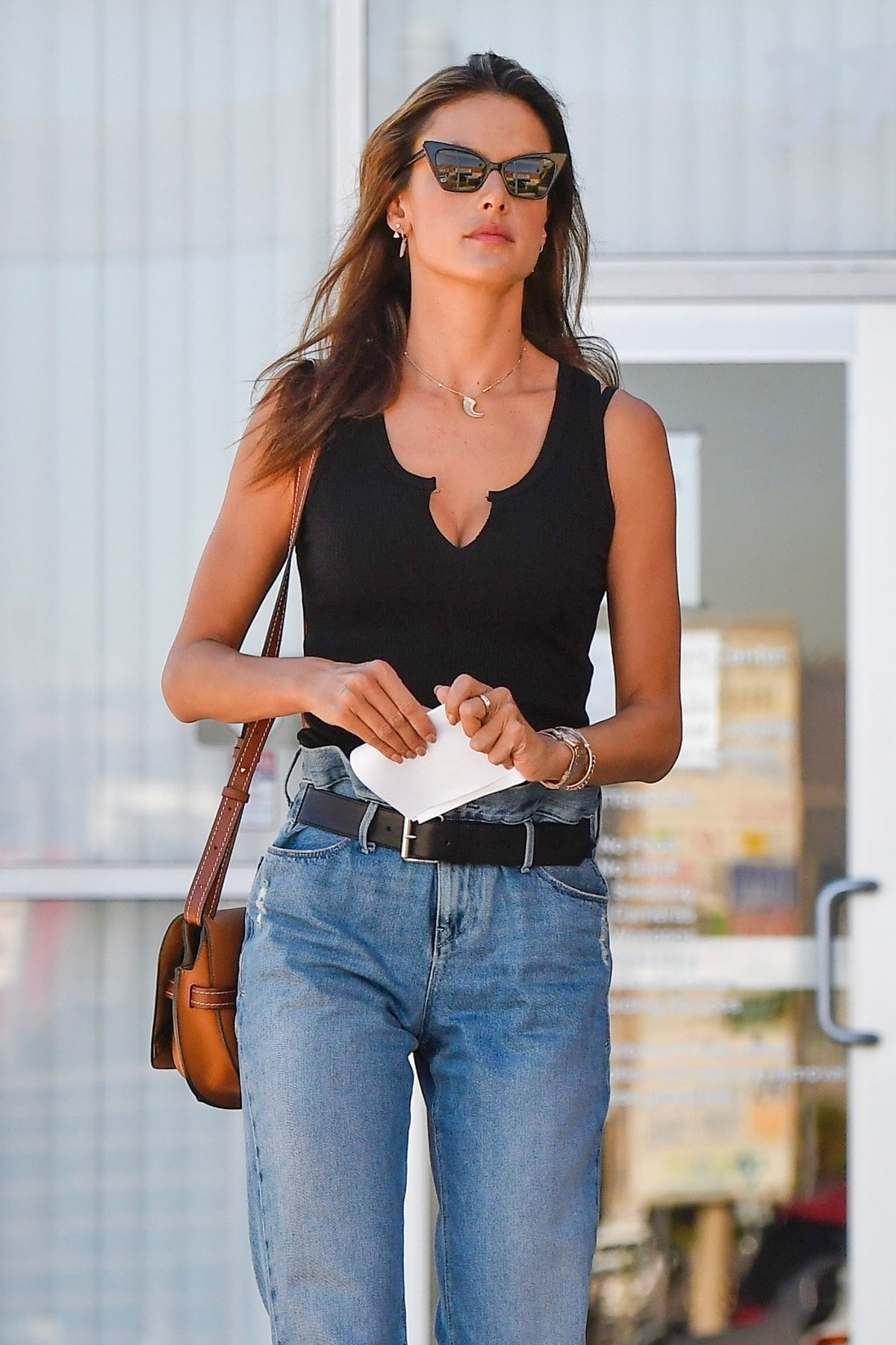 Alessandra Ambrosio in Black Top and Blue Jeans out in Los Angeles 2019/11/18 21