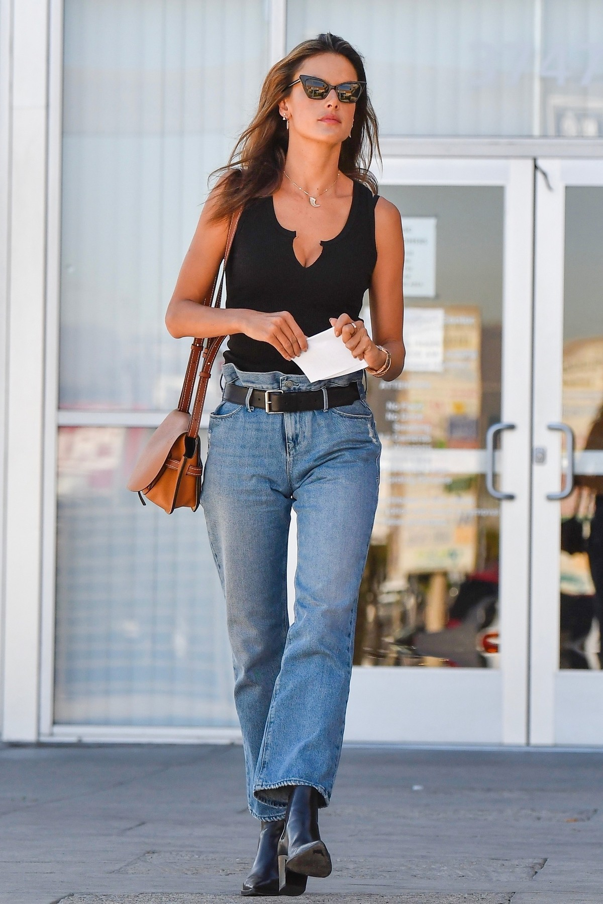 Alessandra Ambrosio in Black Top and Blue Jeans out in Los Angeles 2019/11/18 22