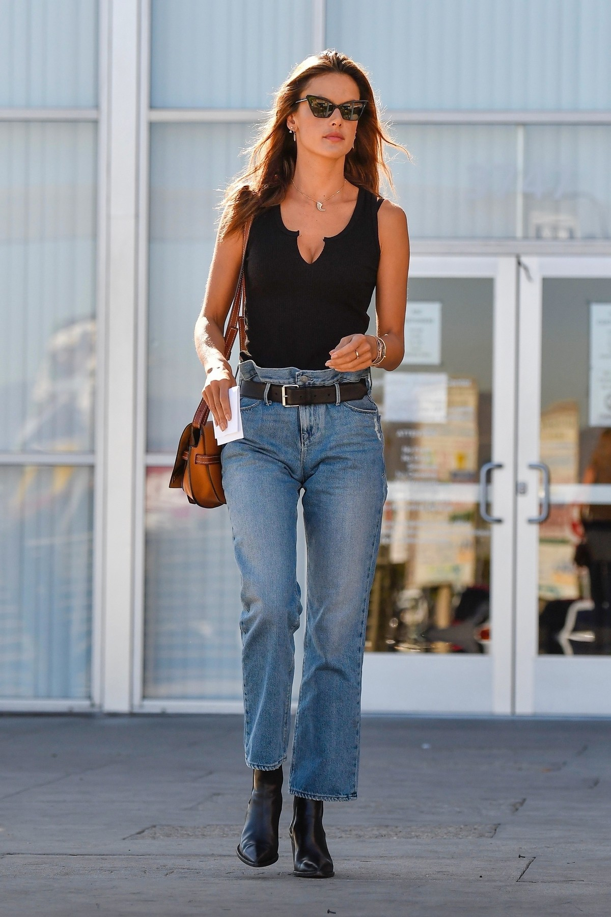 Alessandra Ambrosio in Black Top and Blue Jeans out in Los Angeles 2019/11/18 23