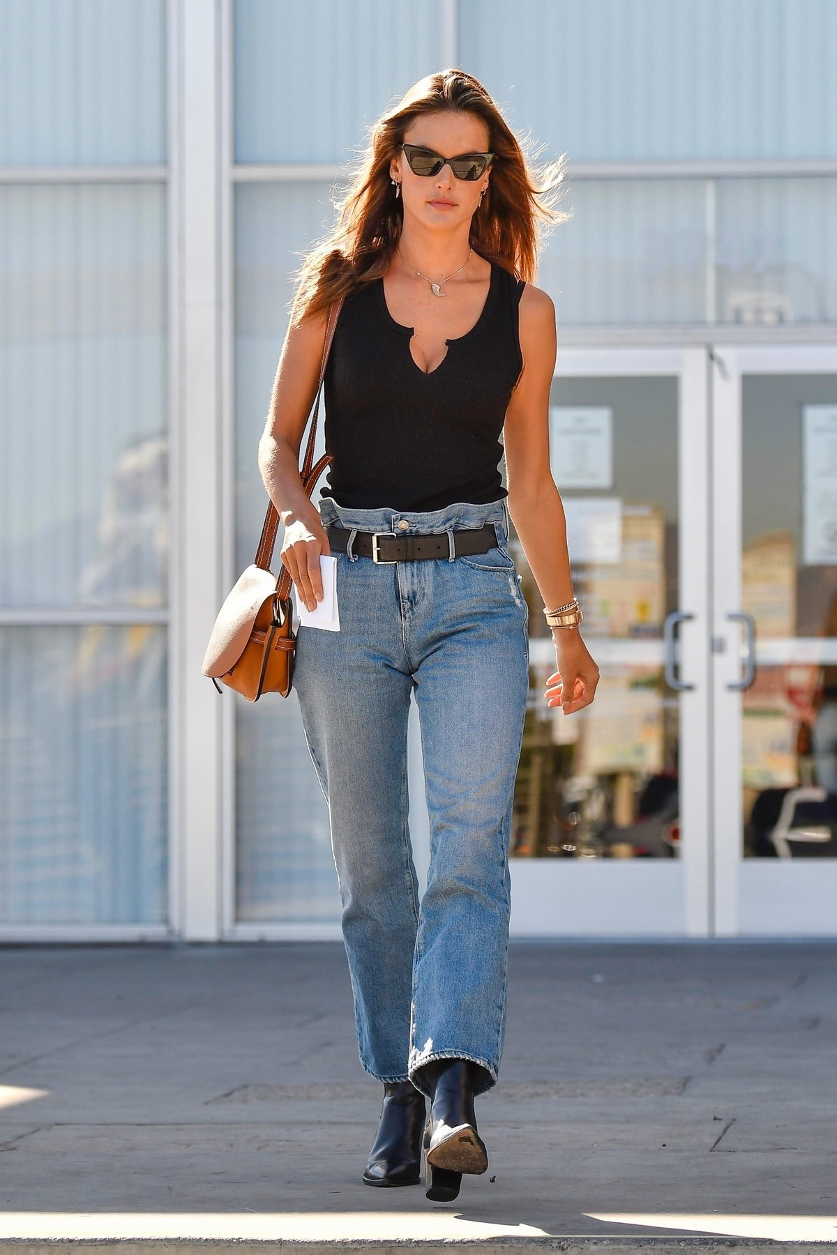 Alessandra Ambrosio in Black Top and Blue Jeans out in Los Angeles 2019/11/18 24